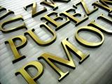 litery mosiężne